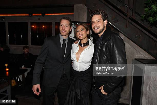 Producer Gabe Polsky actress Eva Mendes and producer Alan Polsky attend the screening after party for the 'Bad Lieutenant' at the Avenue on November...