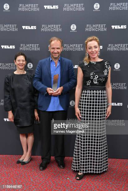 Producer Gabrielle Tana, actor Ralph Fiennes and Diana Iljine at the CineMerit Gala for Ralph Fiennes during the Munich Film Festival at Gasteig on...