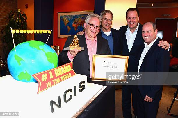 Producer Gary Glasberg actor Mark Harmon Armando Nuñez and CBS Paramount president David Stapf celebrate 'NCIS' being named he mostwatched drama in...