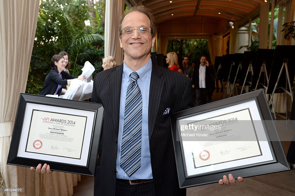 Producer Gary Michael Walters poses with his awards at the 15th Annual AFI Awards Luncheon at Four Seasons Hotel Los Angeles at Beverly Hills on January 9, 2015 in Beverly Hills, California.