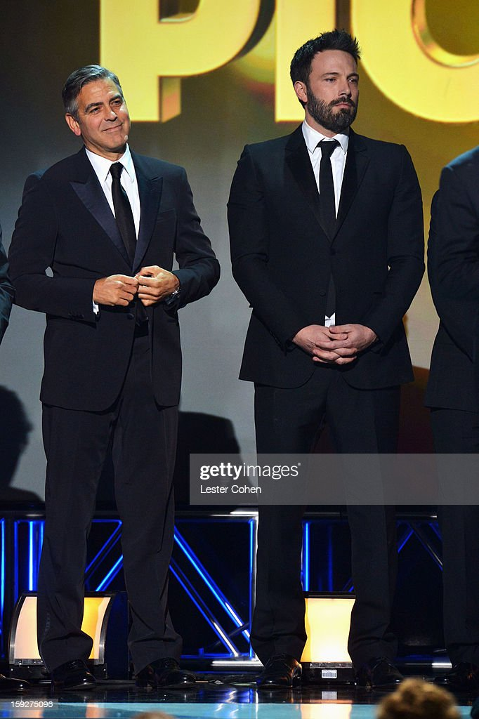 Producer George Clooney and director Ben Affleck speak onstage during the 18th Annual Critics' Choice Movie Awards at The Barker Hanger on January 10, 2013 in Santa Monica, California.