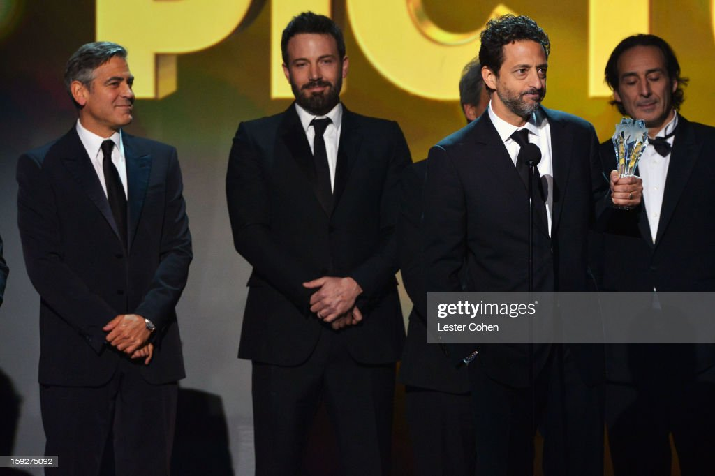 Producer George Clooney, director Ben Affleck and producer Grant Heslov speak onstage during the 18th Annual Critics' Choice Movie Awards at The Barker Hanger on January 10, 2013 in Santa Monica, California.