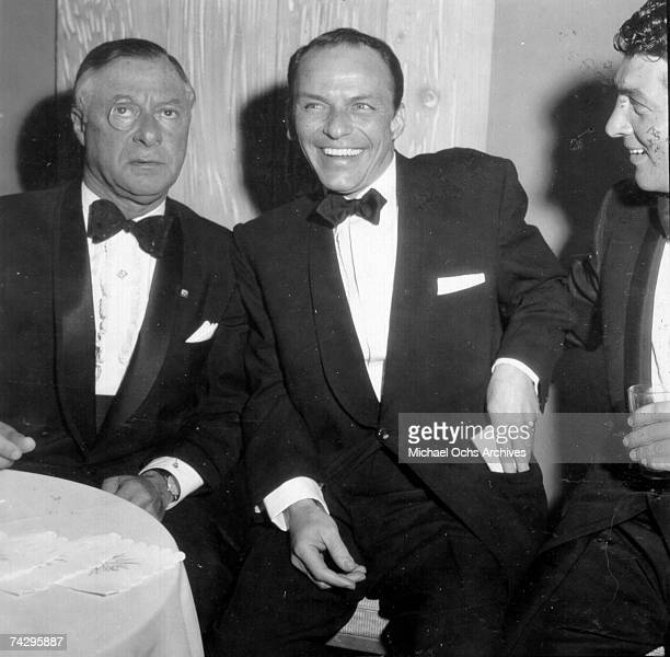 Producer George Jessel singer Frank Sinatra and singer and fellow Rat Pack member Dean Martin attend a Friar's Club dinner on February 14 1957 in Los...