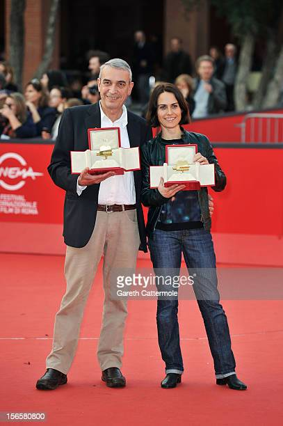 Producer Gianfilippo Pedote poses with the Tao Due Camera d'Oro 2012 Best Producer Award for the movie 'Tutti Parla di Te' and Claudia Pandolfi poses...
