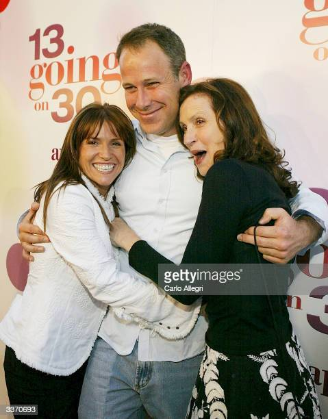 "Producer Gina Matthews, executive producer Todd Garner and producer Donna Roth attend the premiere of the film ""13 Going on 30"" at the Mann Village..."