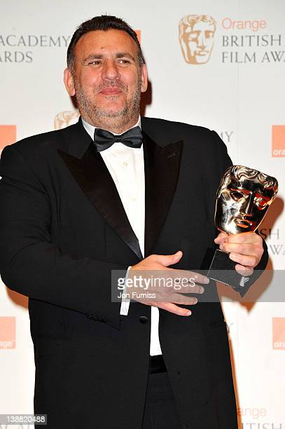 Producer Graham King poses in the press room with the Animated Film award for Rango during the Orange British Academy Film Awards 2012 at the Royal...