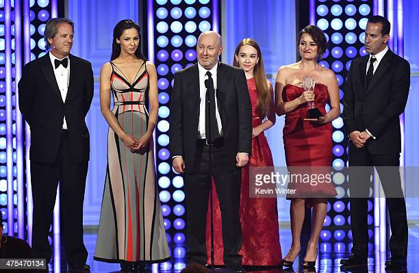 Producer Graham Yost actress Annet Mahendru producer Joe Weisberg actors Holly Taylor Alison Wright and producer Darryl Frank accept the Best Drama...