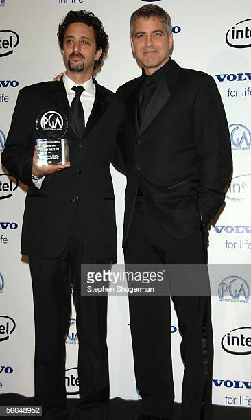 Producer Grant Heslov and actor George Clooney pose in the press room at the 2006 Producers Guild awards held at the Universal Hilton on January 22...