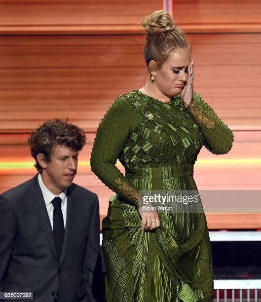Producer Greg Kurstin and recording artist Adele accept the Album Of The Year award for '25' onstage during The 59th GRAMMY Awards at STAPLES Center...