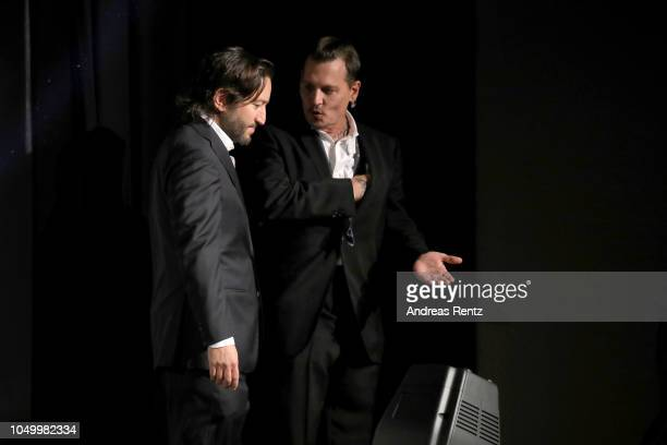 Producer Greg Shapiro and Johnny Depp leave the stage after a QA during the 'Richard Says Goodbye' premiere during the 14th Zurich Film Festival at...