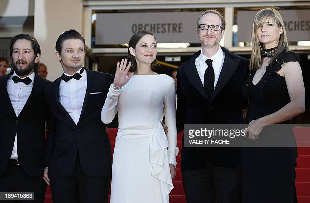 US producer Greg Shapiro US actor Jeremy Renner French actress Marion Cotillard and US director James Gray and his wife Alexandra Dickson pose on May...