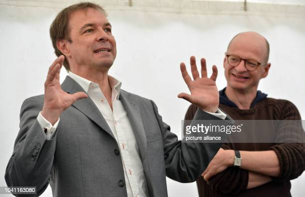Producer Gunnar Dedio and director and author Jan Peter speak to journalists during a shooting break on set in EschsurAlzette Luxembourg 5 May 2017...