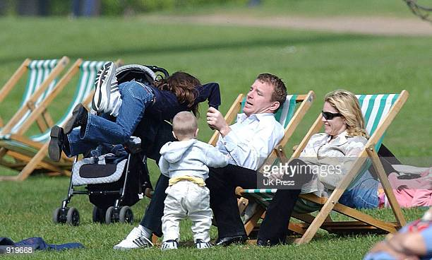 Producer Guy Ritchie plays with singer Madonna's daughter Lourdes while Madonna and her son Rocco watch during an outing in Hyde Park April 21 2002...