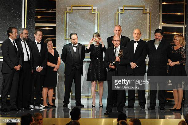 Producer Harry Friedman and co-producers accept an Emmy Award for Outstanding Game/Audience Participation Show for 'Jeopardy!' onstage during the...