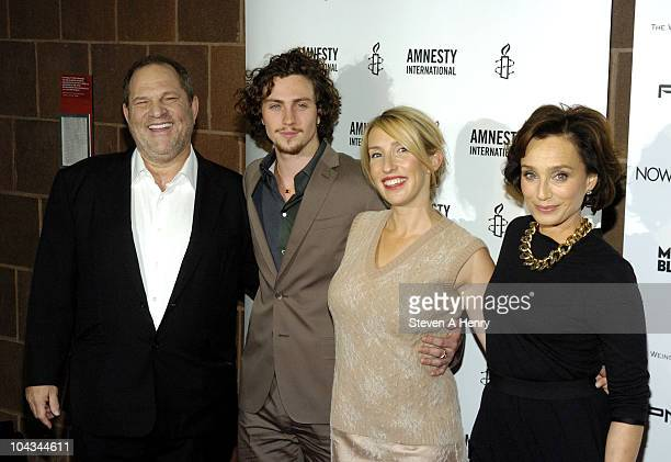 Producer Harvey Weinstein actor Aaron Johnson director Sam Taylor Wood and actress Kristen Scott Thomas attends the Nowhere Boy premiere at the...