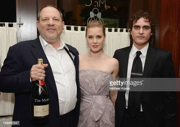 Producer Harvey Weinstein actress Amy Adams and actor Joaquin Phoenix attend Moet Chandon and the HFPA Toast The Weinstein Company Golden Globe...