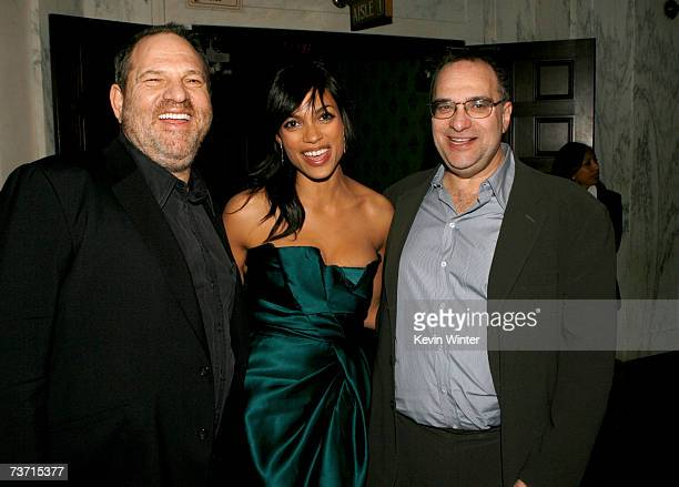 Producer Harvey Weinstein actress Rosario Dawson and producer Bob Weinstein arrive to the premiere of Grindhouse at the Orpheum Theatre on March 26...