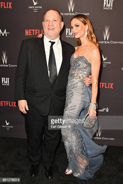 Producer Harvey Weinstein and designer Georgina Chapman attend The Weinstein Company and Netflix Golden Globe Party presented with FIJI Water Grey...