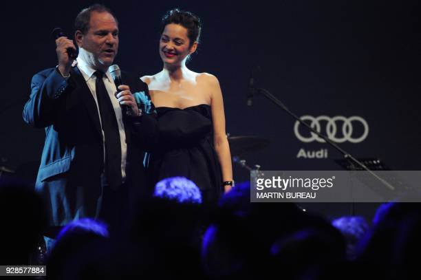 US producer Harvey Weinstein and French actress Marion Cotillard lead the auction at amfAR's Cinema Against Aids 2010 benefit gala on May 20 2010 in...