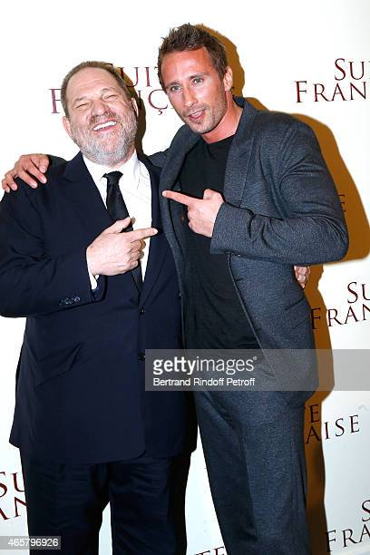 Producer Harvey Weinstein and Matthias Schoenaerts attend the world premiere of 'Suite Francaise' at Cinema UGC Normandie on March 10 2015 in Paris...