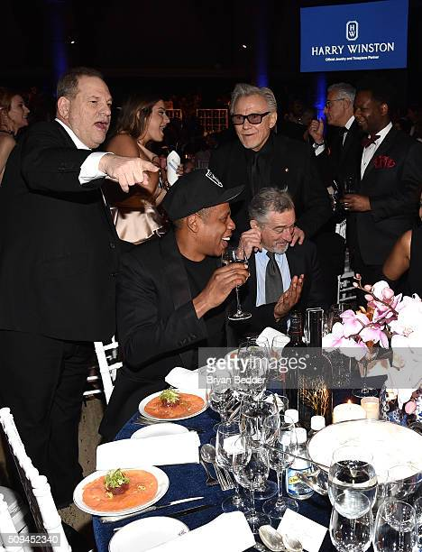 Producer Harvey Weinstein recording artist Jay Z actor Harvey Keitel and actor Robert De Niro are seen during Moet Chandon Toasts to the amfAR Gala...