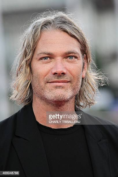 US producer Hunter Gray poses on the red carpet as he arrives for the screening of 'Alex of Venice' during the 40th Deauville American Film Festival...