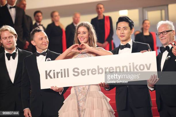 Producer Ilya Stewart actors Roman Bilyk Irina Starshenbaum actor Teo Yoo and Cannes Film Festival Director Thierry Fremaux with a sign to free...