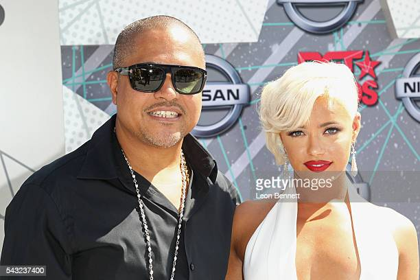 Producer Irv Gotti and recording artist Ashley Martelle attend the Make A Wish VIP Experience at the 2016 BET Awards on June 26 2016 in Los Angeles...