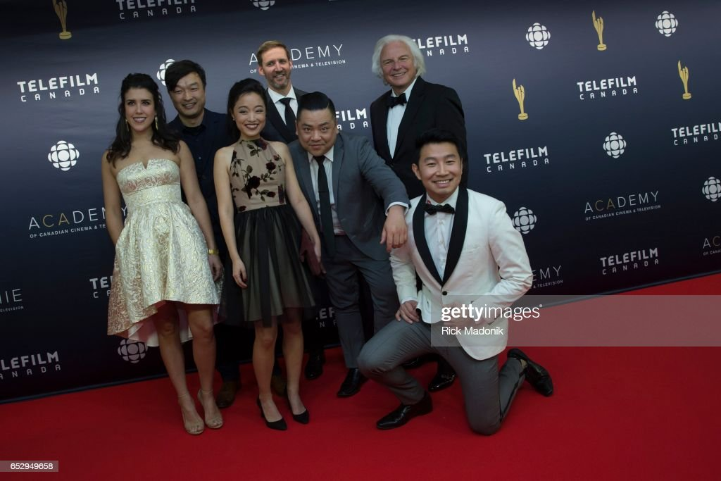 Producer Ivan Pecan with the cast of Kim's Convenience. Canadian Screen Awards red carpet at Sony Centre for the Performing Arts ahead of the show.