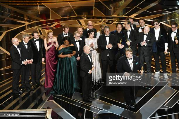 Producer J Miles Dale director Guillermo del Toro and cast/crew accept Best Picture for 'The Shape of Water' onstage during the 90th Annual Academy...