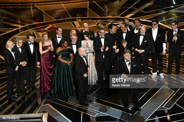 Producer J. Miles Dale , director Guillermo del Toro and cast/crew accept Best Picture for 'The Shape of Water' onstage during the 90th Annual...