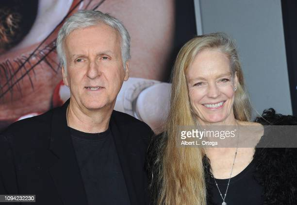 Producer James Cameron and actrss Suzy Amis arrive for the Premiere Of 20th Century Fox's Alita Battle Angel held at Westwood Regency Theater on...
