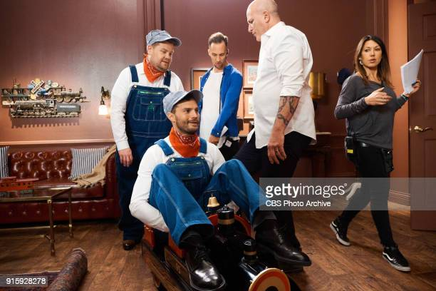 Producer James Longman set decorator Lou Trabbie and stage manager Teri Pensky Hlubik with James Corden and Jamie Dornan in the sketch '50 Trains of...