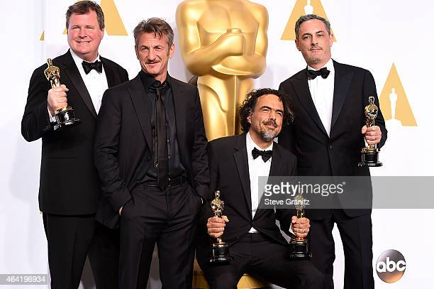 Producer James W Skotchdopole actor Sean Penn producer/director Alejandro G Inarritu and producer John Lesher pose in the press room during the 87th...