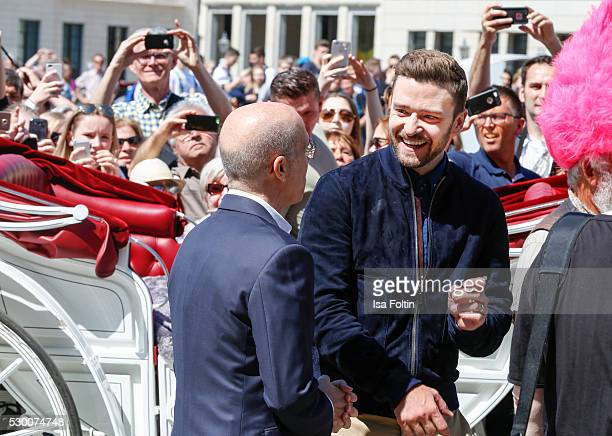 Producer Jeffrey Katzenberg and US Actor Grammy and EmmyAward Winner Justin Timberlake attend the photocall for the film 'Trolls' at Brandenburg Gate...