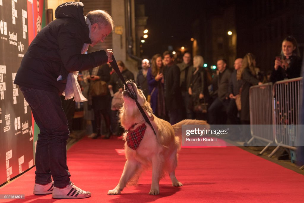 Producer Jeremy Dawson plays on the red carpet with Visit Scotland ambassador George during the UK premiere of 'Isle of Dogs' and opening gala of the 14th Glasgow Film Festival at Glasgow Film Theatre on February 21, 2018 in Glasgow, Scotland.