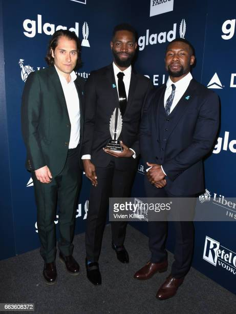 Producer Jeremy Kleiner screenwriter Tarell Alvin McCraney and actor Trevante Rhodes pose with the Outstanding Film Wide Release award for...