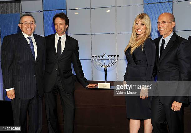 Producer Jerry Bruckheimer actress Emily Proctor and CEO of DreamWorks animation Jeffrey Katzenberg pose after the show at the Simon Wiesenthal...