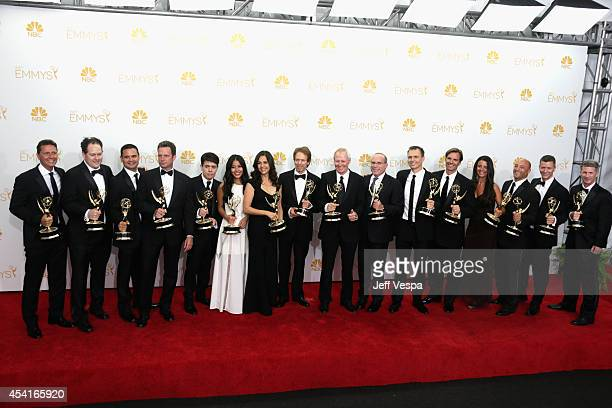 Producer Jerry Bruckheimer and fellow producers of 'The Amazing Race' pose in the press room during the 66th Annual Primetime Emmy Awards at Nokia...