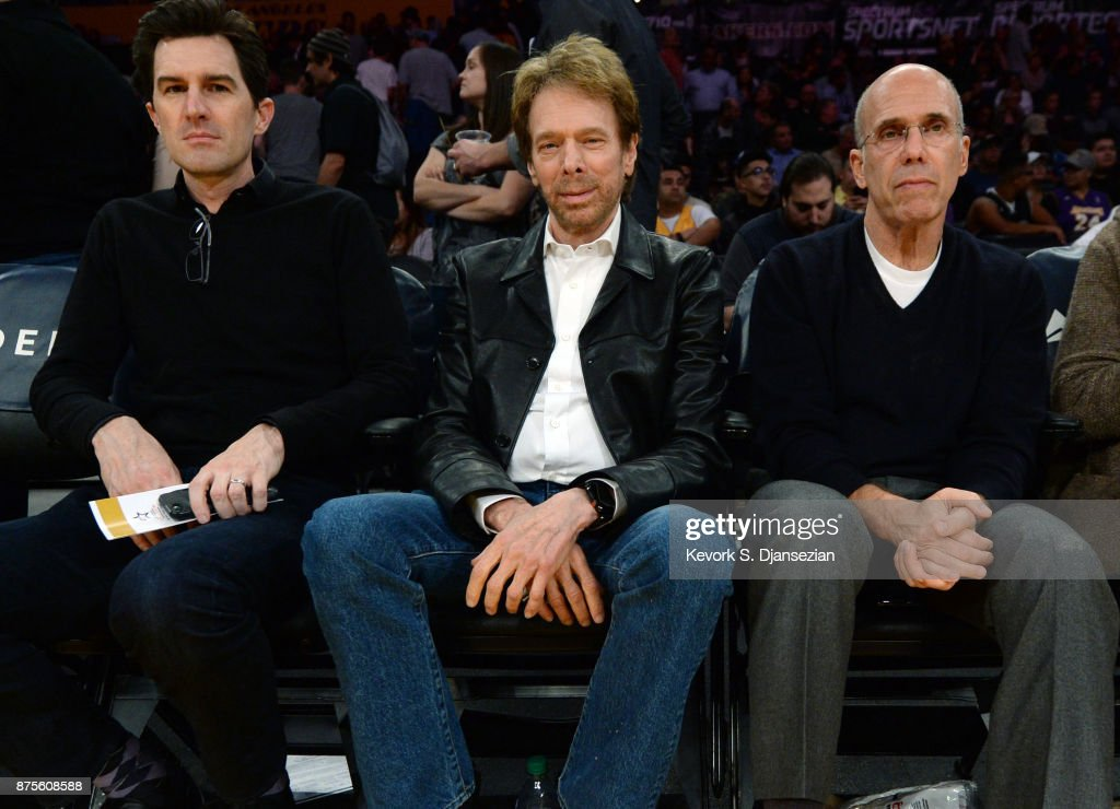 Producer Jerry Bruckheimer (C) and Jeffrey Katzenberg (R) attend Phoenix Suns and Los Angeles Lakers basketball game at Staples Center November 17, 2017, in Los Angeles, California.