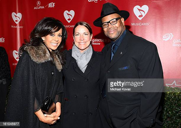 Producer Jimmy Jam with wife Lisa Padilla and guest attend MusiCares Person Of The Year Honoring Bruce Springsteen at the Los Angeles Convention...