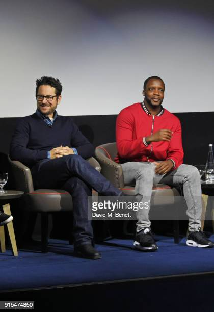 Producer JJ Abrams and actor Roger Davies speak on stage at a fan screening of The Cloverfield Paradox hosted by Netflix at The Ham Yard Hotel on...