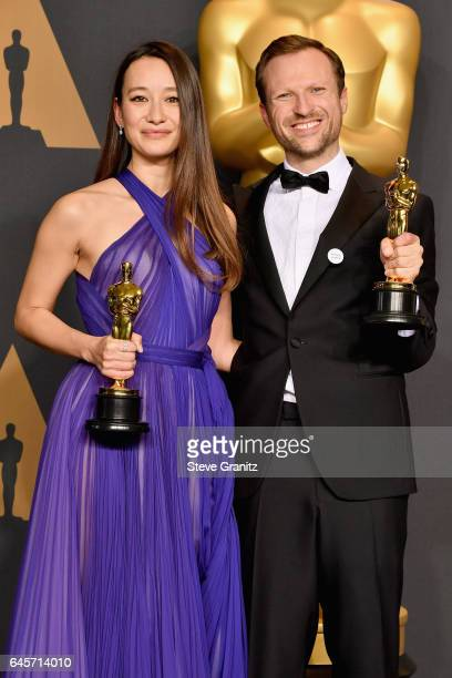 Producer Joanna Natasegara and director Orlando von Einsiede winners of the best Documnetary Short Subject for 'The White Helmets' pose in the press...