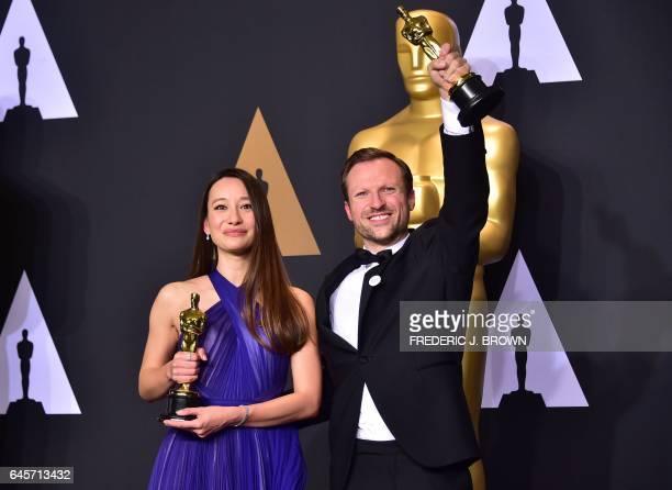 TOPSHOT Producer Joanna Natasegara and director Orlando von Einsiedel winners of Best Documentary Short Subject for 'The White Helmets' pose in the...