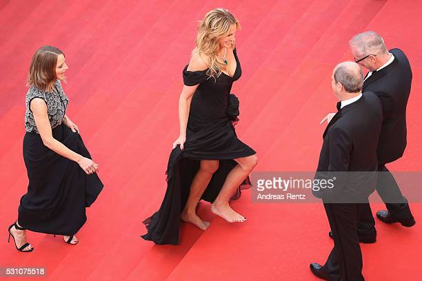 Producer Jodie Foster and actress Julia Roberts walking bare foot walk up upon their arrival at the 'Money Monster' premiere during the 69th annual...