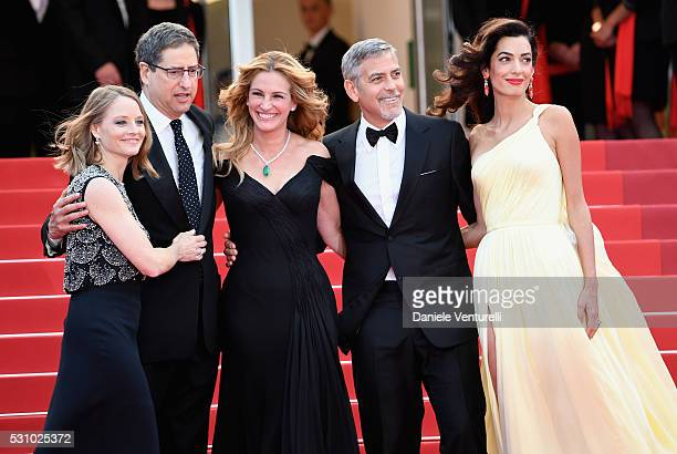 Producer Jodie Foster guest actors Julia Roberts George Clooney and his wife Amal Clooney attend the Money Monster premiere during the 69th annual...