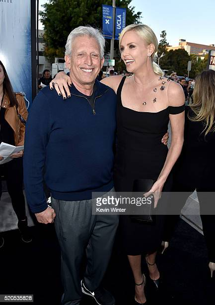 """Producer Joe Roth and actress Charlize Theron attend the premiere of Universal Pictures' """"The Huntsman: Winter's War"""" at the Regency Village Theatre..."""