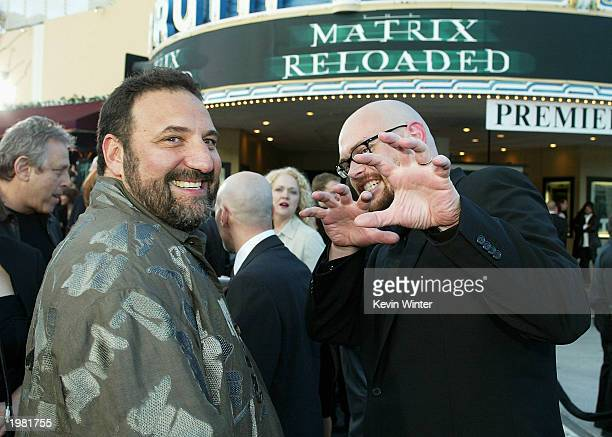 Producer Joel Silver and director Andy Wachowski talk at the premiere of The Matrix Reloaded at the Village Theater on May 7 2003 in Los Angeles...