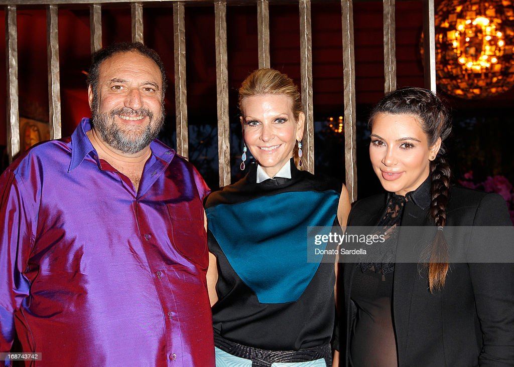 Producer Joel Silver, Karyn Silver and Kim Kardashian attend a celebration of Jennifer Meyer's CFDA Swarovski nomination hosted by Rodarte at the residence of Joel and Karyn Silver on May 11, 2013 in Los Angeles, California.