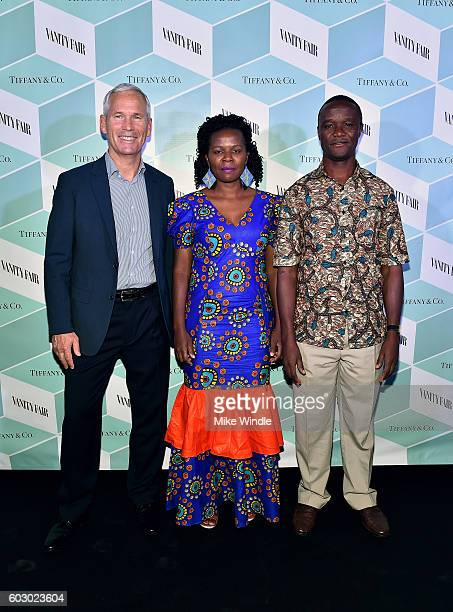 Producer John Carls Sarah Katende and Robert Katende attend the Vanity Fair and Tiffany Co private dinner toasting Lupita Nyong'o and celebrating...